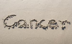 cancer written on beach